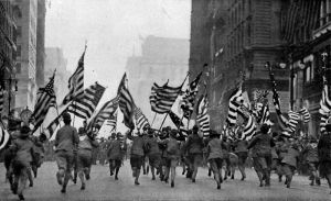 Boy Scouts running in parade down Fifth Avenue in New York City. (National Geographic Magazine, 1917)